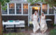 two brides running in the rain on their wedding day Cape Cod wedding