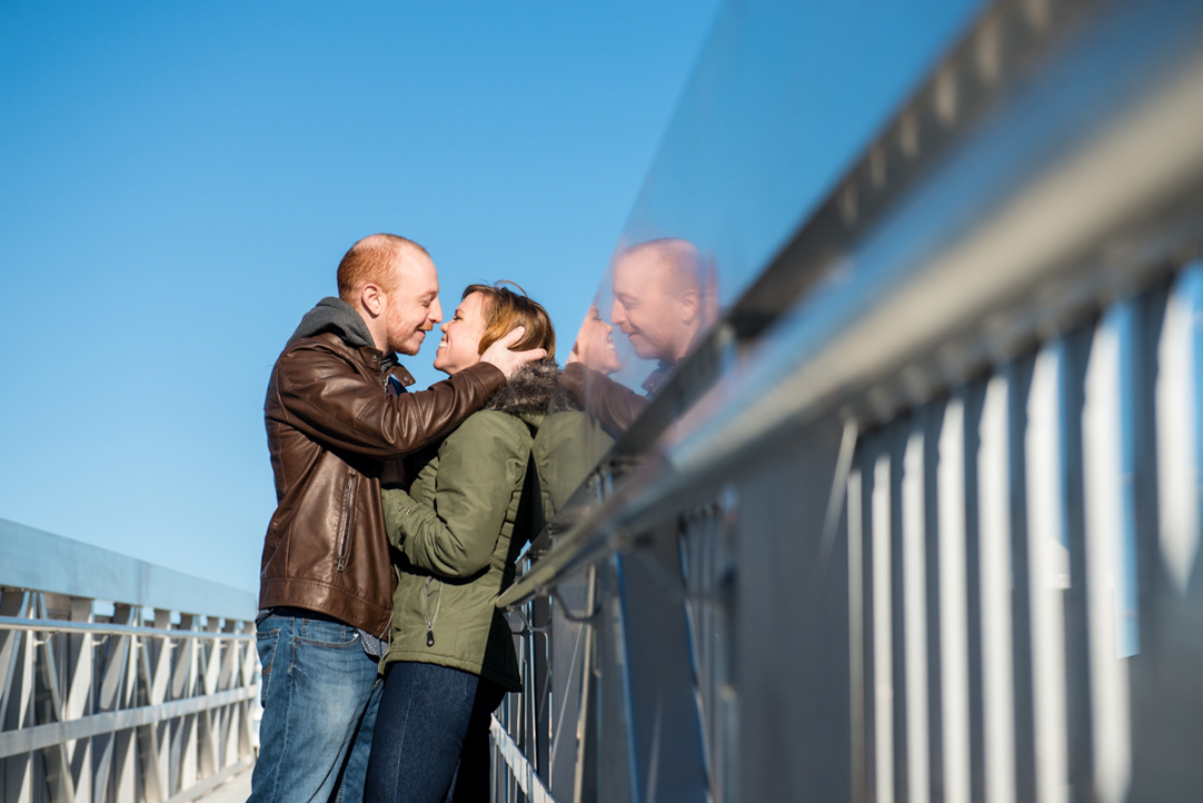 couple kissing with cool reflection engagement photo seaport boston