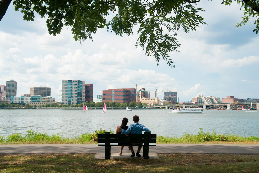 sitting on a bench by the Charles River engagement session boston