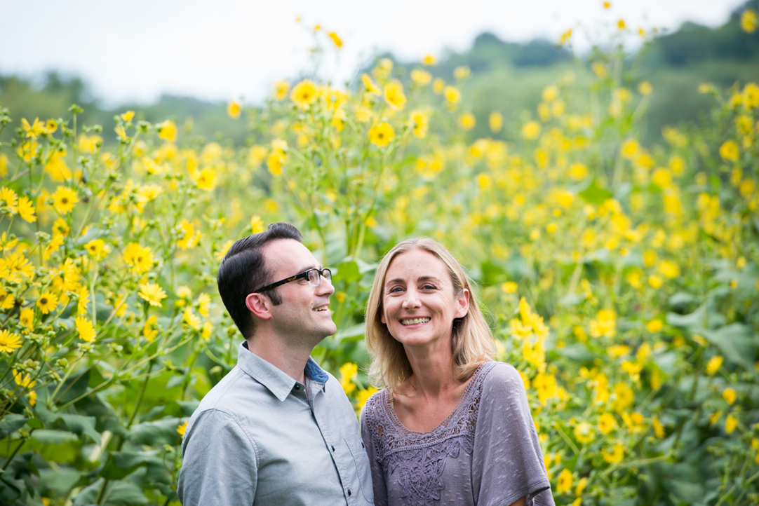 smiling couple with yellow flowers behind them arnold arboretum