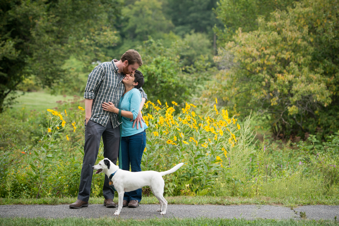 cute couple and their dog in the arnold arboretum