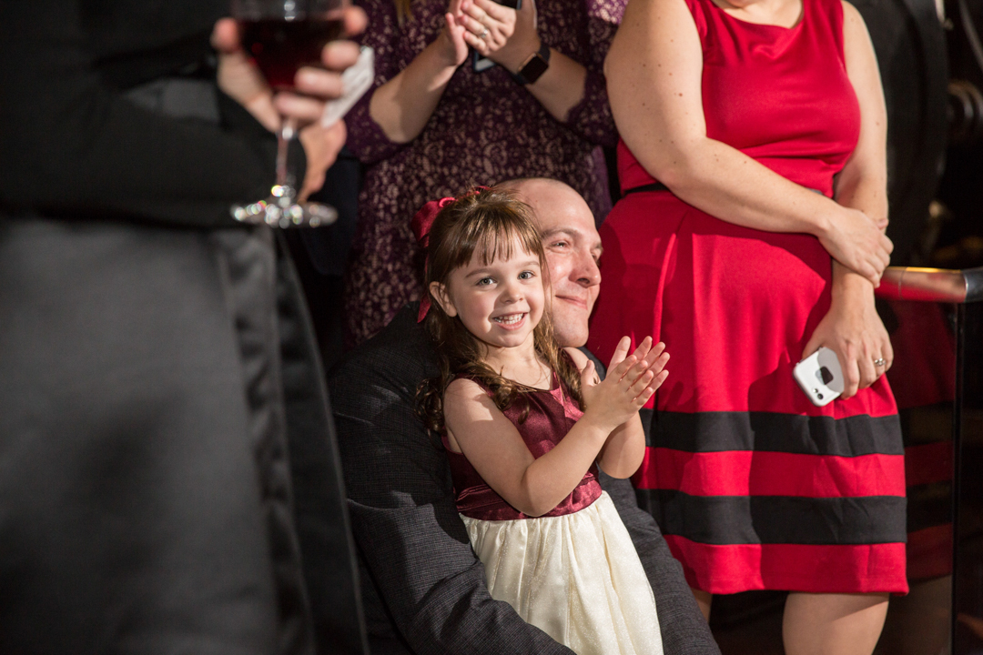 cute-kid-smiling-and-clapping-at-wedding