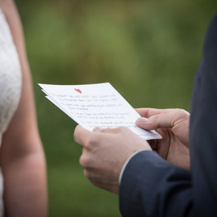 Groom reading from notes