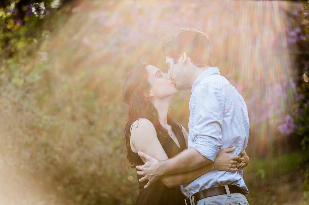 sundrenched-kiss-engagement-photo