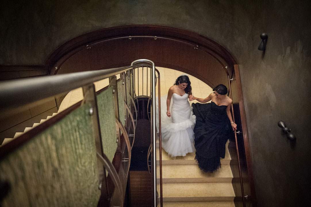 two-brides-walking-down-stairs-ritz-carlton-wedding