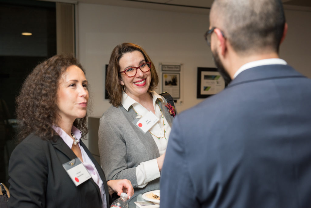 candid laughter at non-profit reception