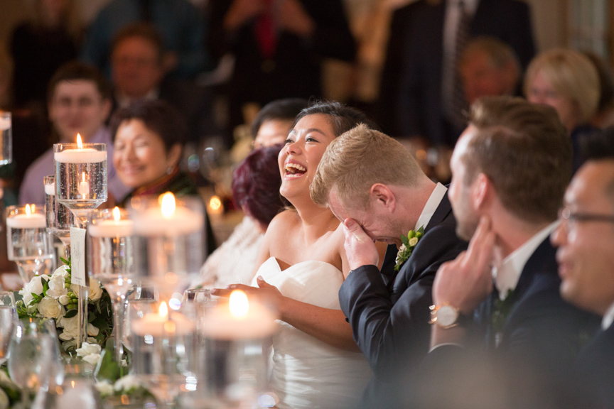 bride and groom react to great wedding toast