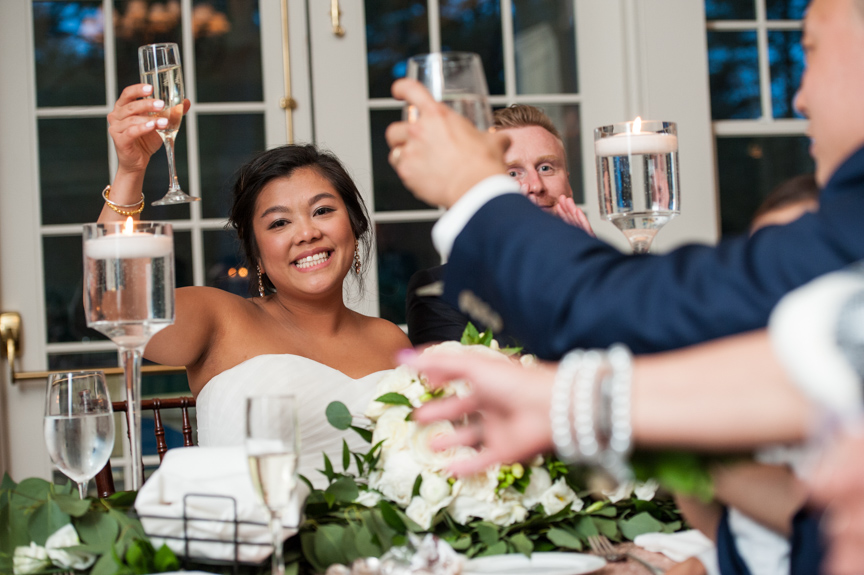 bride raises her glass in a toast