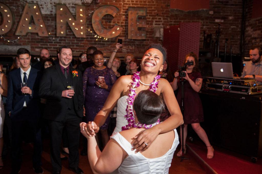 two brides laugh while dancing bella luna jamaica plain wedding