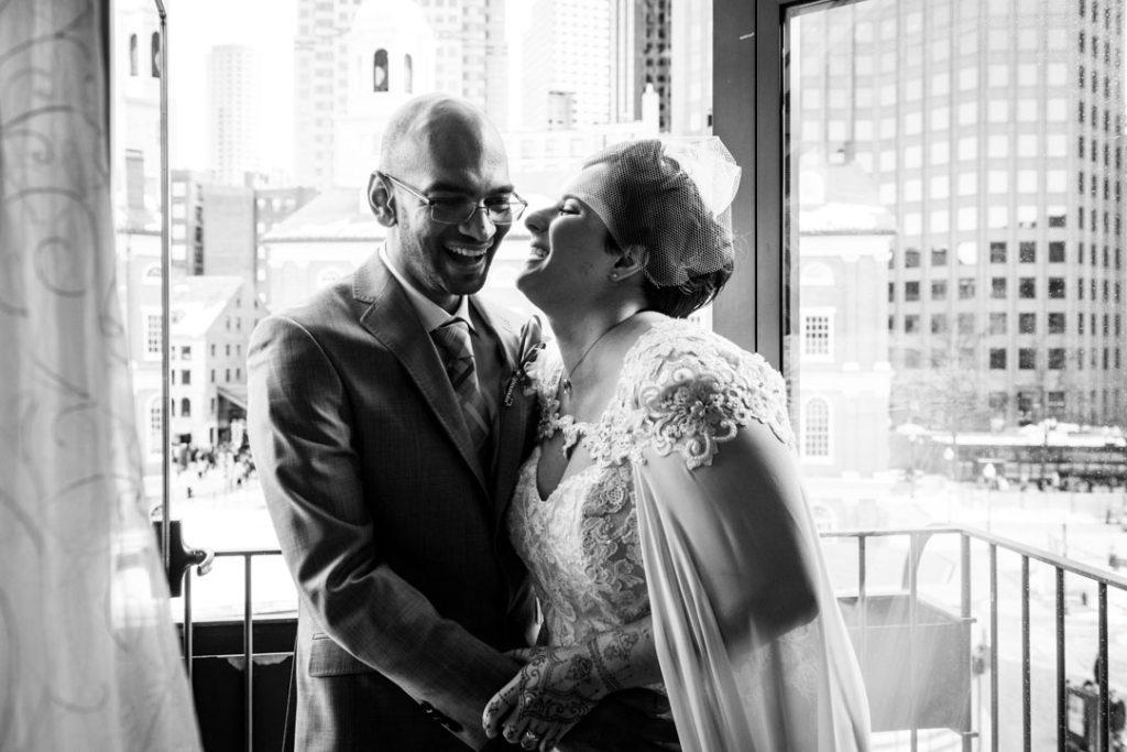 bostonian hotel wedding couple on balcony laughing
