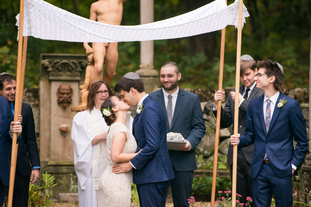 codman estate wedding couple kisses under a chuppah