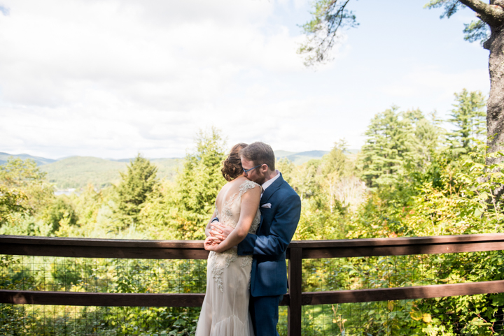 couple pose for a photo outside before a fall wedding in Vermont