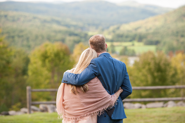 the groom and his mom embrace during his wedding reception with a backdrop of Vermont mountains