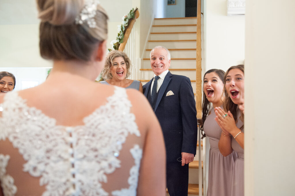 reactions on faces as people see woman in her wedding dress