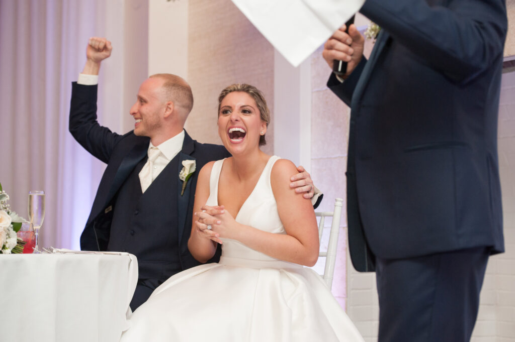 bride laughs in reaction to a wedding toast