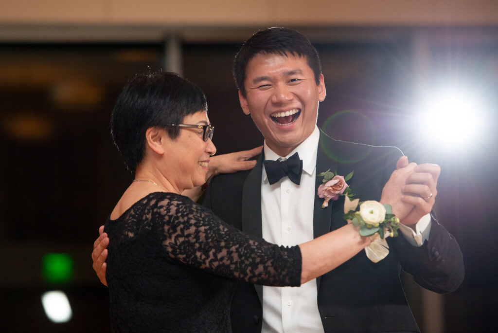 man dancing with mother during his wedding